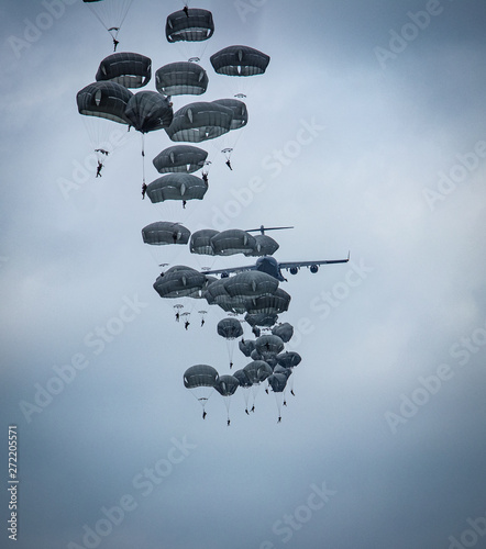 Photo parachutist helicopter airborne operations airplane explosions missiles