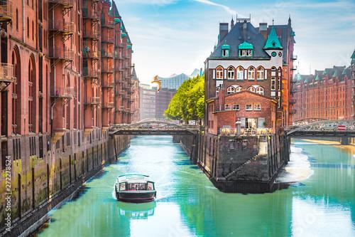 Fotografiet Hamburg Speicherstadt harbor district with tour boat in summer, Germany