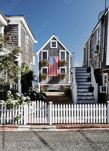 Obraz na płótnie United States flag at suburban neighborhood