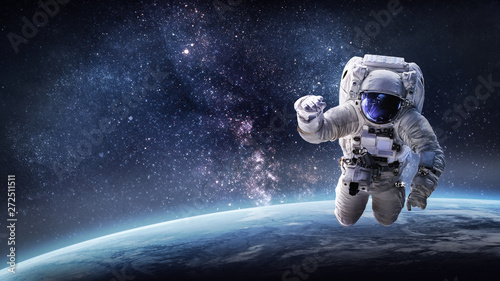 Fotografering Astronaut in outer space on orbit of the Earth