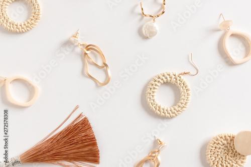 Fényképezés Pattern made of earrings on white background