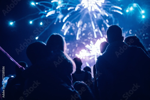 Fotografering Crowd watching fireworks and celebrating new year eve