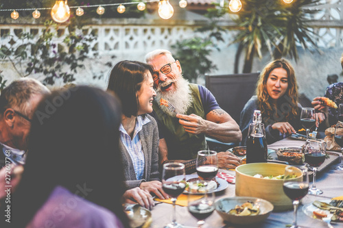 Happy family people having fun at barbecue dinner - Multiracial friends eating a Fototapete