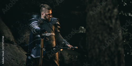 Foto Knight with sword and crossbow