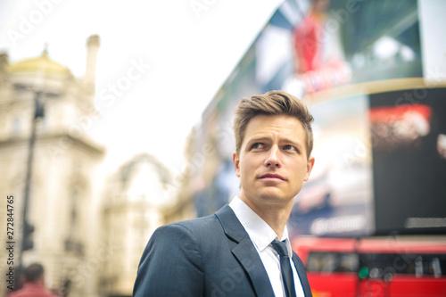 фотография Attractive elegant man walking in the street