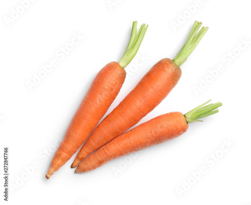 Tableau sur Toile Fresh ripe carrots on white background, top view