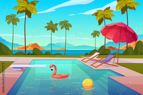 Fotografija Swimming pool in hotel or resort outdoors, empty poolside with chaise lounges, umbrella, inflatable flamingo and ball in water, exotic beach landscape seaview background