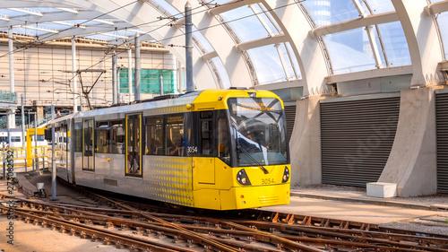 Light rail Metrolink tram in the city center of Manchester, UK