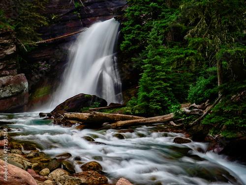 Obraz na plátně Peaceful waterfall from melting Ice - Glacier National Park