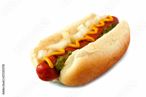 Fotografie, Obraz Hot dog with mustard, onions and relish, side view isolated on a white backgroun