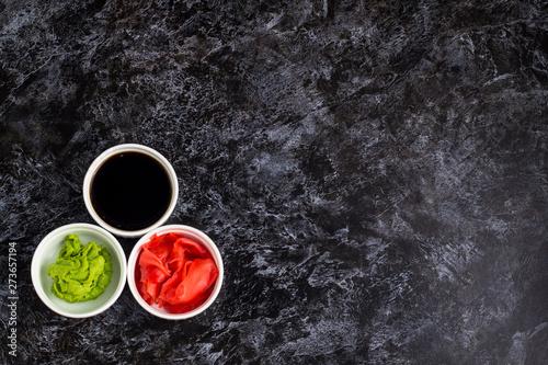 Fototapeta Set for sushi soy sauce ginger wasabi with chopstick on stone background
