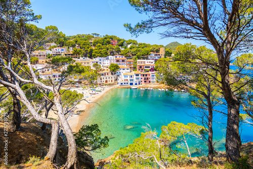 View of colorful houses in sea bay with beach in Sa Tuna coastal village, Costa Fototapet
