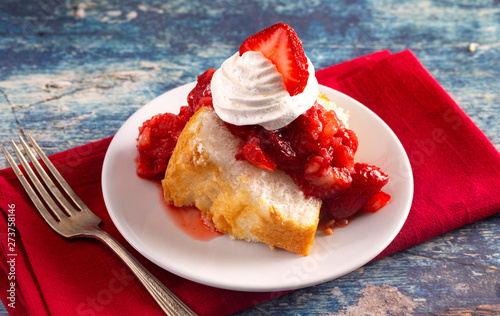 Vászonkép Slice of Strawberry Short Cake Made with Angel Food Cake and Strawberry Sauce