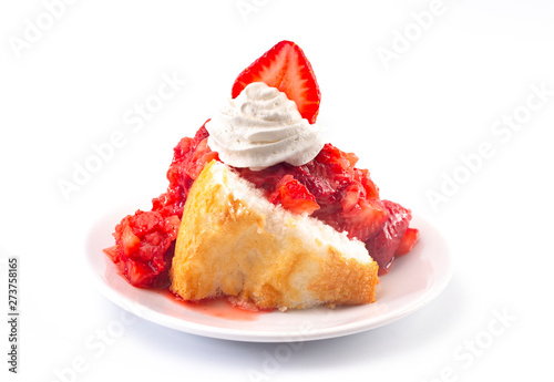 Fényképezés A Strawberry Short Cake Made with Angel Food Cake and Strawberry Sauce