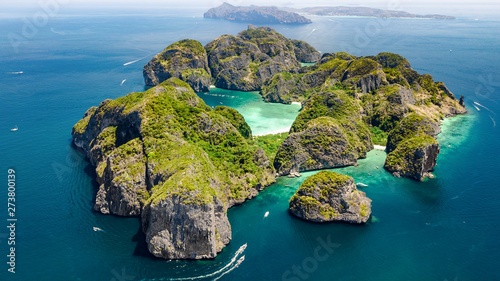 фотография Aerial drone view of tropical Ko Phi Phi island, beaches and boats in blue clear