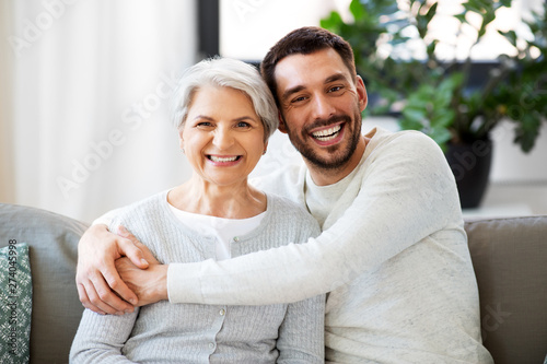 Wallpaper Mural family, generation and people concept - happy smiling senior mother with adult s