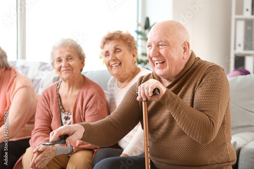 Canvas Print Group of senior people spending time together in nursing home