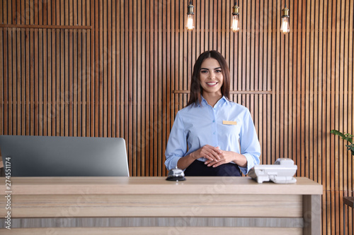 Fototapeta Portrait of receptionist at desk in lobby