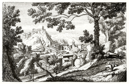 Fotografie, Tablou Ancient medieval mountain town inserted in a natural landscape with woods on foreground and hills on background