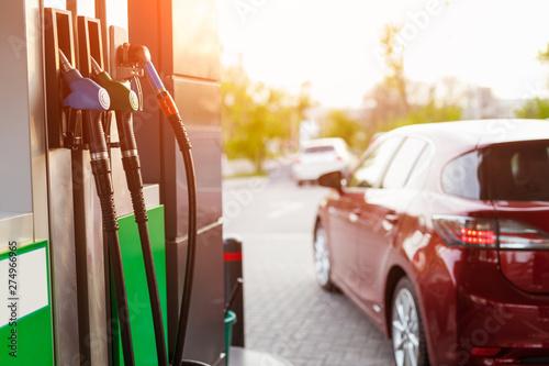 Fuel pump and car on filling station Fototapeta
