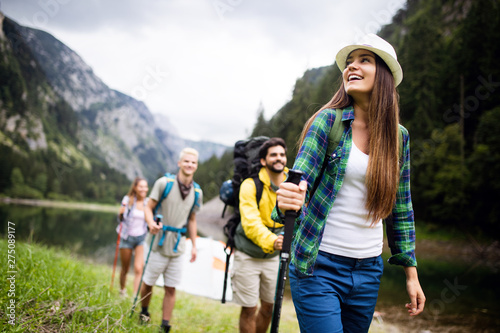 Group of young friends hiking in countryside Fototapeta