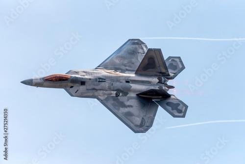 Obraz na plátně Advanced Tactical Fighter Jet Against Blue Skies