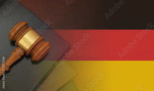 Photo Gavel and legal book on wooden table, collage with german flag
