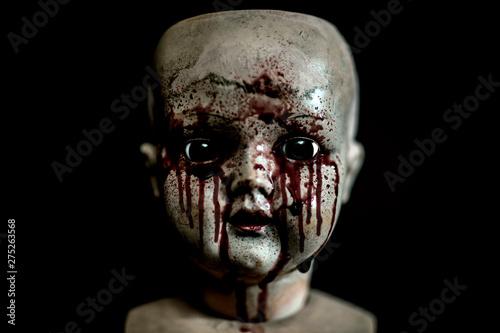 Fotografiet Creepy bloody doll in the dark