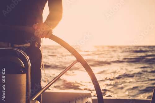 Canvas Print Close up of man's hand on sail boat helm - marine ship lifestyle concept of trav
