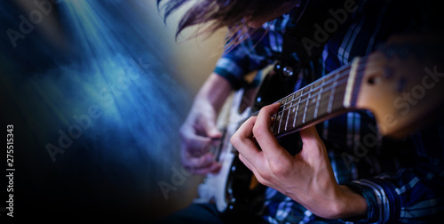 Electric guitar playing. Young men playing electric guitar Fototapeta
