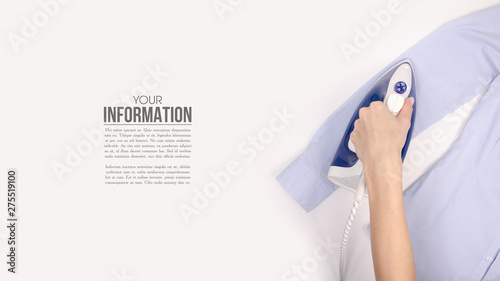 Fotografia, Obraz Blue iron in hand blue shirt on ironing board top view, household, sample text o