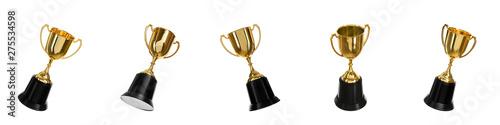 Fototapeta Set of shiny gold trophy cups on white background. Banner design