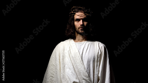Fotografering Jesus in robe and crown of thorns looking into camera, Christian faith, religion