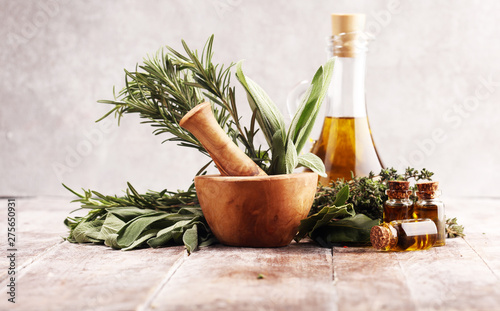 Tablou Canvas Fresh herbs from the garden and the different types of oils for massage and arom