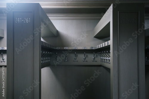 Metal hangers with numbers in cloakroom Fototapeta