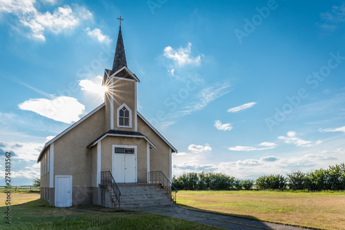 Canvas Suburst over the steeple of the historic Nordland Lutheran Church on the prairie