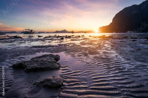 Fotografie, Obraz Tropical beach in ebb time low tide on sunset