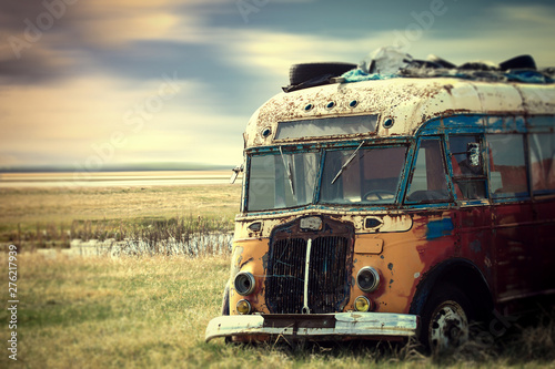 Fototapeta Brightly colored vintage hippy van parked in the countryside