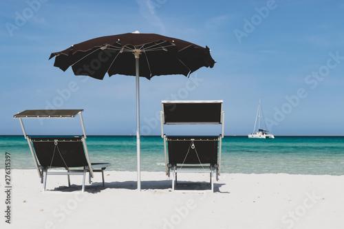 sea and beach umbrella and chaise longue on a white beach - La Cinta, San Teodor Poster Mural XXL