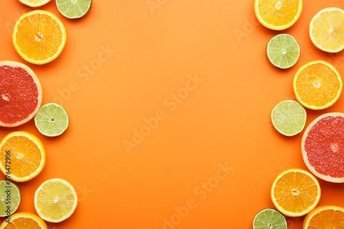 Fototapeta Many different citrus fruits on color background