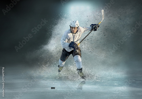 Canvas Print Caucassian ice hockey Players in dynamic action in a professiona