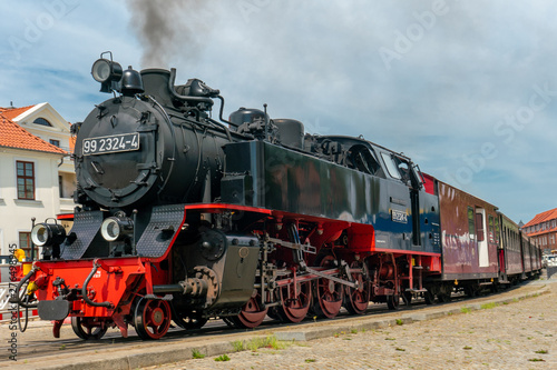 Wallpaper Mural ancient steam railway engine Molli in Bad Doberan
