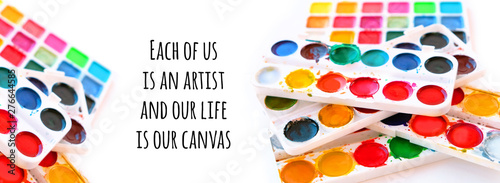 Each of us is an artist, and our life is our canvas - inspiration motivation quote on defocused art composition. colorful paint watercolor, drawing art creativity, artist concept. soft selective focus