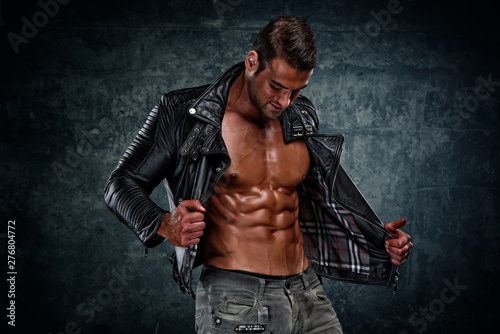 Canvas Print Handsome Athletic Male Fashion Model in Leather Jacket and Jeans