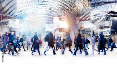 Fotografia Beautiful motion blur of walking people in train station