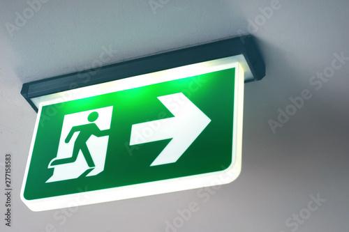 Emergency door escape light sign Fototapeta