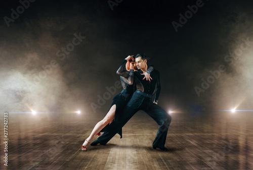 Billede på lærred Elegant dancers, ballrom dance on theatre stage