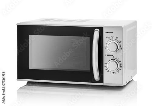 Fotografie, Tablou White microwave oven on a white background.