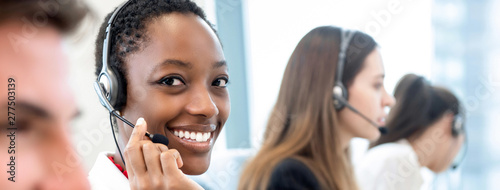 Fotografía Smiling beautiful African American woman working in call center with diverse tea