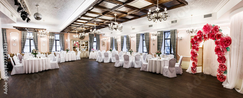 Stampa su Tela Front view at an interior of a banquet hall ready for wedding